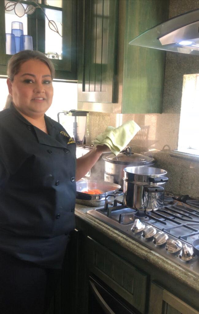 Chef Teresa Hernandez cooking in the kitchen