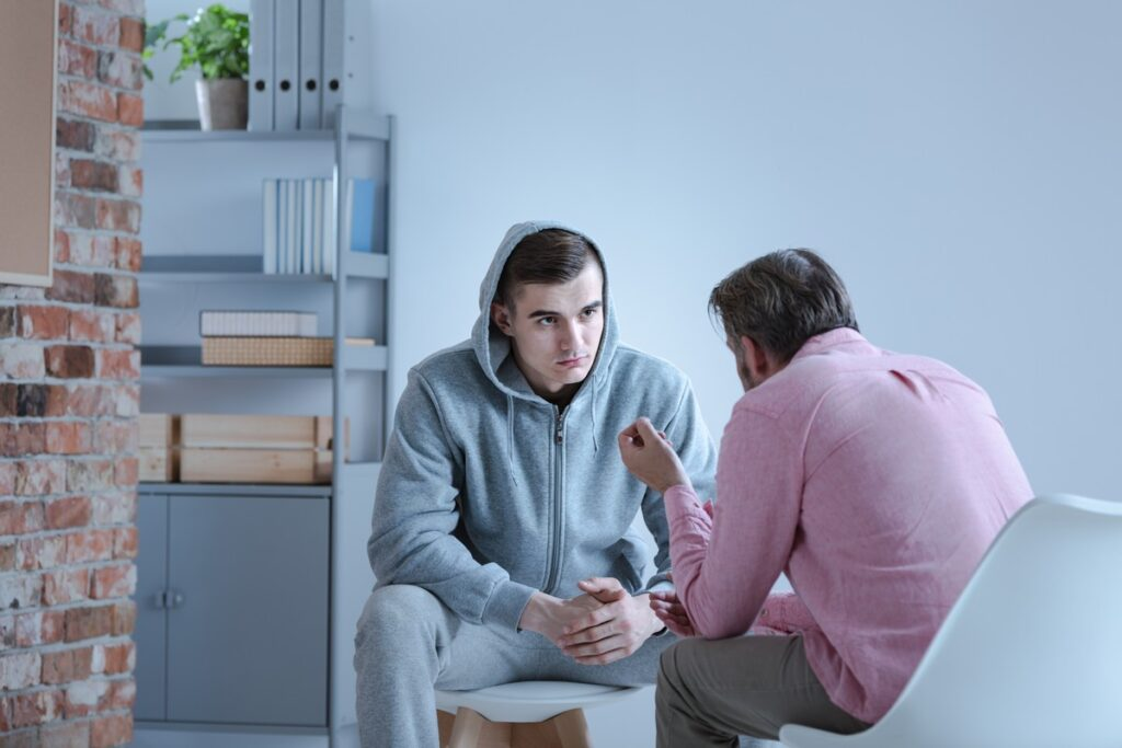 A teenage boy during an individual therapy session