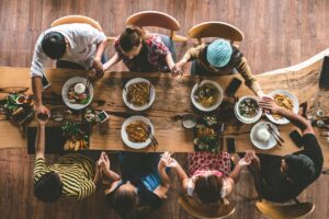 Group of friend pray before having food and drinks