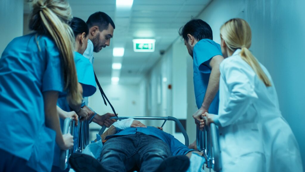 Medical staff in a hurry move patient into operating theater