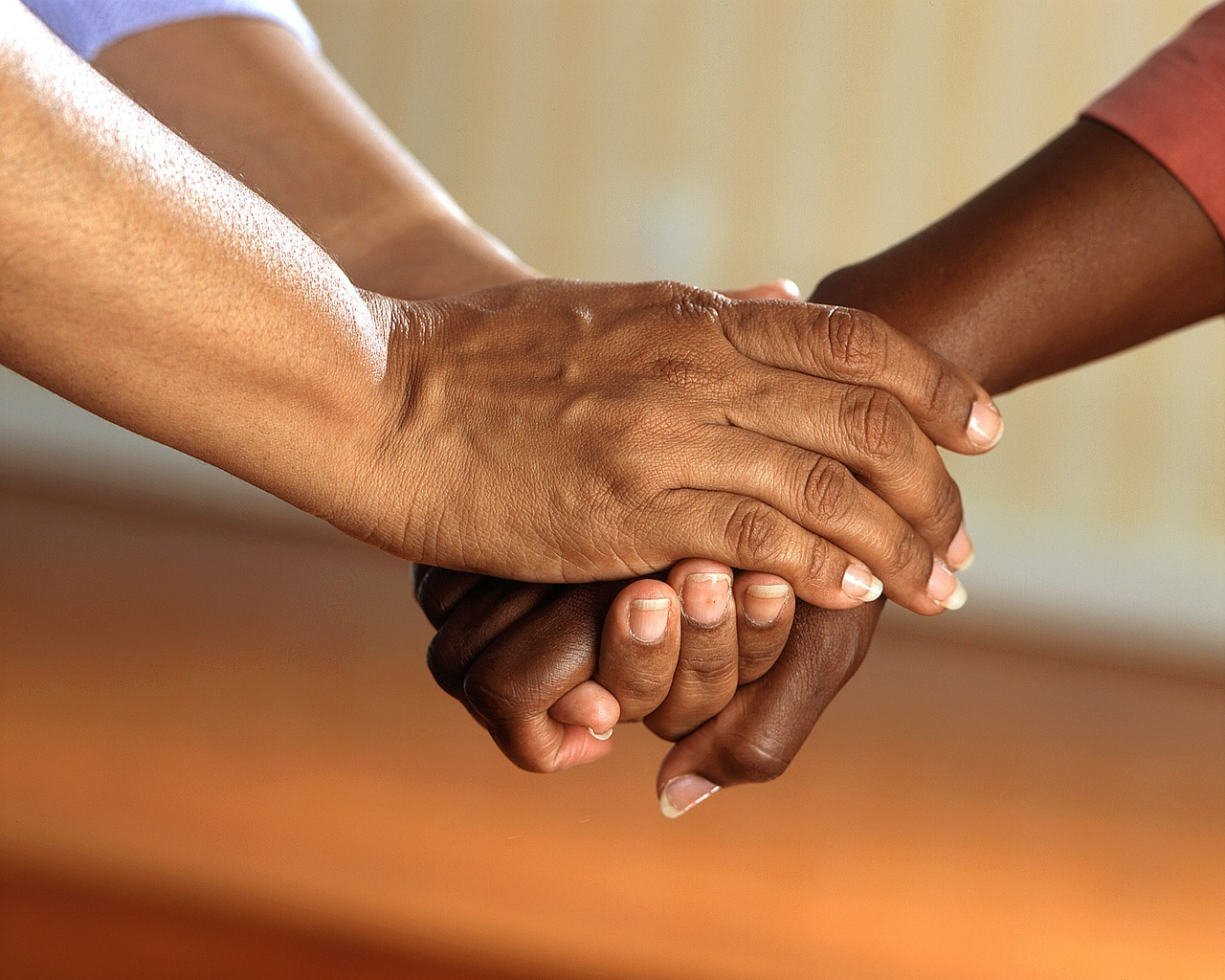 support between two elderly people as they tenderly hold hands