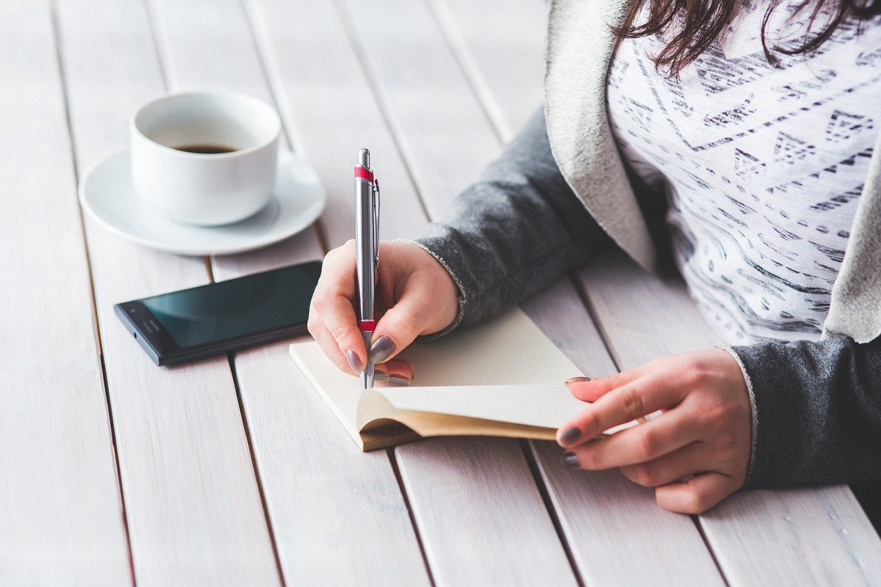 Woman making notes in her notepad